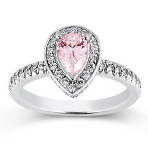 2.20 carats Pear pink  round white diamonds engage
